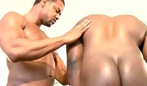 Muscular brown hunk rimming black ass