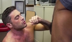 White stud takes long black cock anally in office