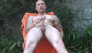 Tattooed stud Lorenzo has a sexy solo show in the backyard