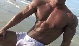 Santi Aragon chiseled athlete posing on the beach in white trunk 1