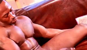 Ripped black hunk tugging thick cock