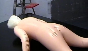 Sexy gay boys have kinky sex with a blow-up doll on table