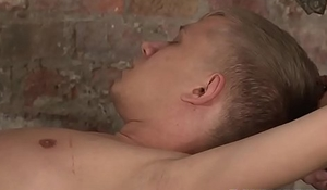 Suspended trollop twink gets a proper rimjob before anal